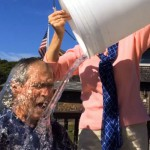 In this image from video posted on Facebook, courtesy of the George W. Bush Presidential Center, former President George W Bush participates in the ice bucket challenge with the help of his wife, Laura Bush, in Kennebunkport, Maine